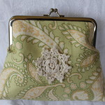 Pale green scroll clutch bag
