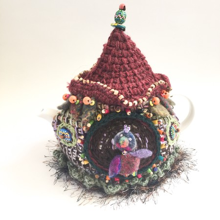 Unique embellished bird house crochet tea cosy. Beads. Felt. Texture.