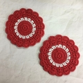 Two Crocheted Coasters in Red and White on a 'My Team' Presentation Card