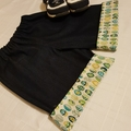 Little hipster shorts with cuff. Dark denim with green leaf print cuff. Size 2