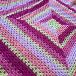 Baby blanket in bright granny stripes