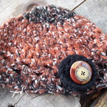 crocheted cloche made from mohair and acrylic yarn. black, white and russet