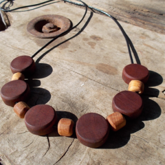 Necklace made from timber beads hand tooled from reclaimed cedar and oak