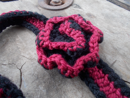 Crocheted headband, maroon and black acrylic with flower