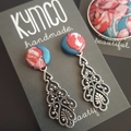 Teal and pink antique-look earrings.
