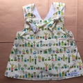 6-12month  baby girls crossover back pinafore with nappy cover, potplant print.