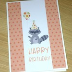 Girls Happy Birthday card - raccoon with balloon