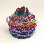 Colourful embellished crochet tea cosy. Beads. Felt. Fluff. One of a kind.