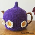 Purple Tea Cosy with a daisy floral border to fit a 4-6 cup pot