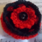 Crocheted clip made from acrylic & wool yarns with vintage buttons black and red