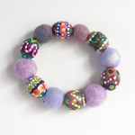 Handmade felt and hand painted bead stretch bracelet. Soft purples/colours.  .