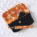 Orange Marimekko and blue denim ladies clutch wristlet bag