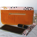 Pink and orange ladies clutch bag with removable wrist strap