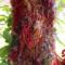Sideways scarf made from silk yarn, multi coloured with burgundy detail
