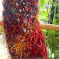 Sideways scarf made from silk yarn, multi coloured with burgundy detail