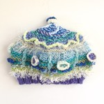 Embellished knitted beanie for baby 3-6 months. Blue/green/purple. Textures.