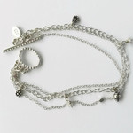Dainty sterling silver multi strand bracelet with small charms