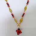 Pretty little necklace in red, black and gold.