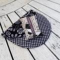 Black and white shoulder bag with panda print tissue holder