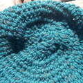 crocheted cloche made from pure wool, teal and black