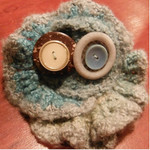 Crocheted clip made from wool and soy blend yarn and vintage buttons