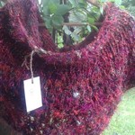 Knitted cowl made from recycled sari silk yarn