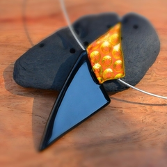 Black and Orange dichroic fused glass flame pendant.