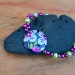 Passion fruit flower beaded bracelet (round)