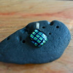 Green and black checkered dichroic fused glass pendant.