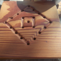 Square trivet hand tooled from reclaimed Canadian Cedar