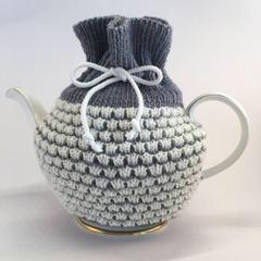 Grey and white pure merino wool tea cosy.
