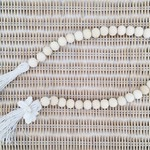 Wood bead and jute garland with shell tassels