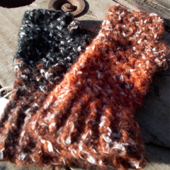 Crocheted fingerless mitts. mohair blend, orange black white and brown size S
