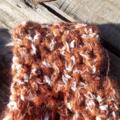 Crocheted fingerless mitts. mohair blend, orange black white and brown size S