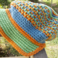 crocheted cap made from cotton/acrylic yarns orange, blue and green ON SALE