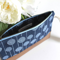 Blue and white clutch bag with wrist strap
