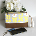 Yellow and grey floral clutch bag with wrist strap