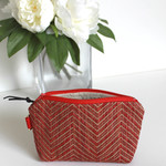 Red and gold chevron patterned zipper bag