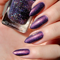 """Nail polish - """"Glitters Reign"""" A dark purple with copper shimmer and glitters"""