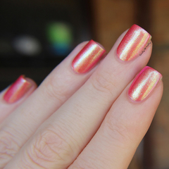 "Nail polish - ""The Uttermost"" A pink / coral base with gold shimmer"
