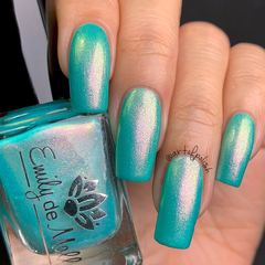 """Nail polish - """"One More Reason"""" A light turquoise green base with pink shimmer"""
