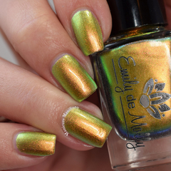 "Nail polish - ""Goddess Of Rays"" A bright golden orange / green multichrome."