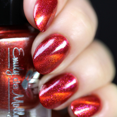 """Nail polish - """"Heated Discussion"""" A dark red base with gold and pink shimmers"""