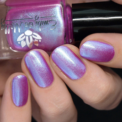 "Nail polish - ""Undertones"" A bright purple with blue to purple shimmer"