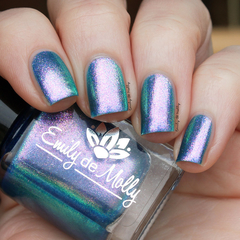 "Nail polish - ""Sea Of Lies"" A blue base with pink / green / blue aurora pigment."