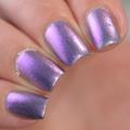 "Nail polish - ""Limerick"" A pale grey base with purple to gold shifting shimmer"