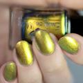 "Nail polish - ""Goddess Of Rays"" A bright golden orange / green multichrome."