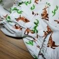 'Desert Kangaroo' - unisex romper in white cotton with kangaroo & cactus print.
