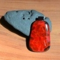 Black Fire- Black, red and amber fritt-migration fused glass pendant.