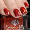 "Nail polish - ""Heated Discussion"" A dark red base with gold and pink shimmers"